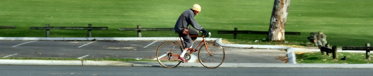 Retired man riding bicycle